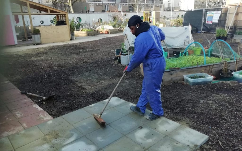 Westminster Kingsway student laying a path